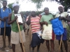 Some members of Tet Ansanm takes a break to receive a water filter and sanitation guide from BIF.